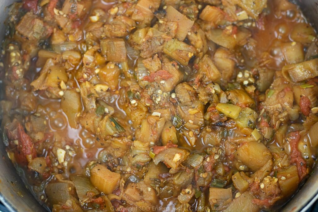 eggplant and vegetables simmering in a dutch oven for eggplant casserole