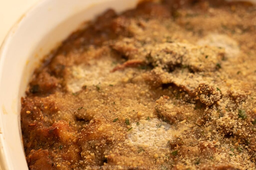 baked creole eggplant casserole in a white baking dish
