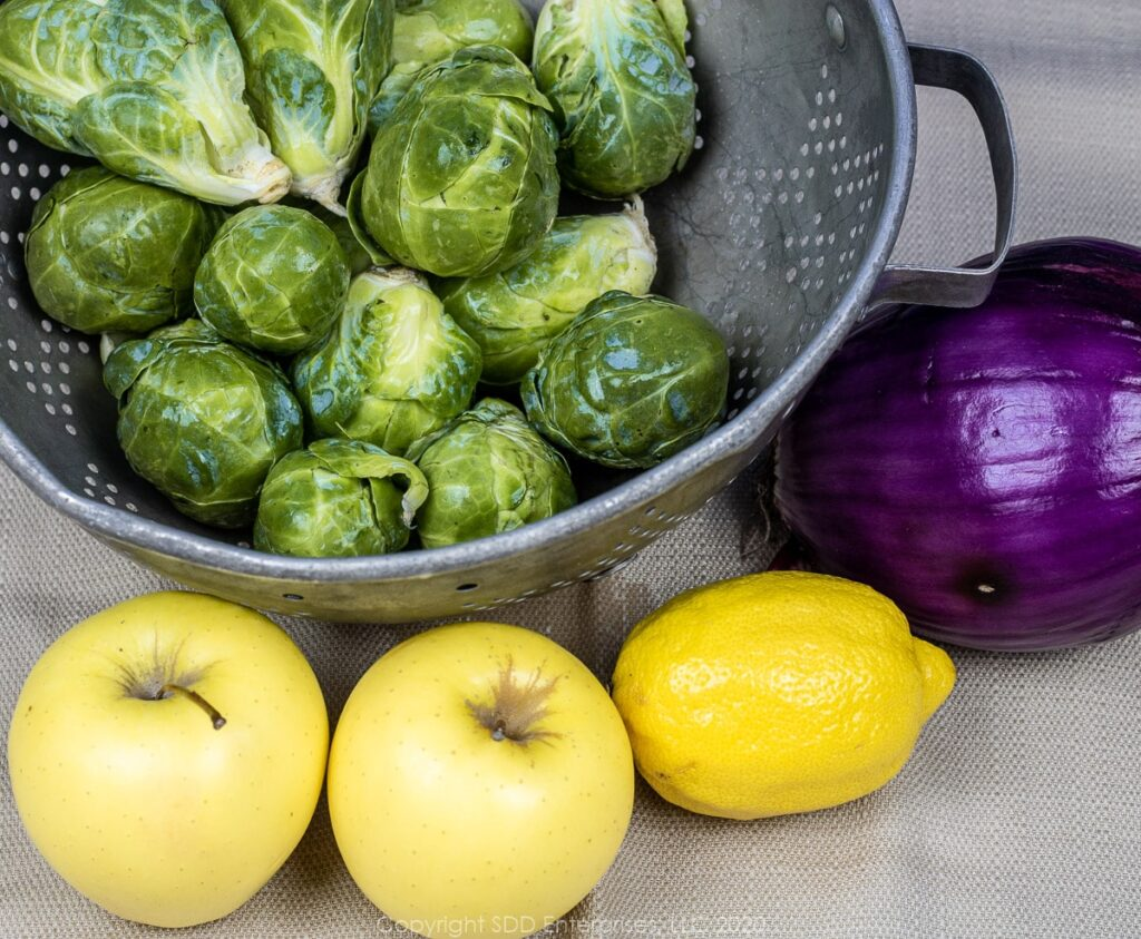 brussels sprouts, red onion, 2 golden delicious apples and a red onion
