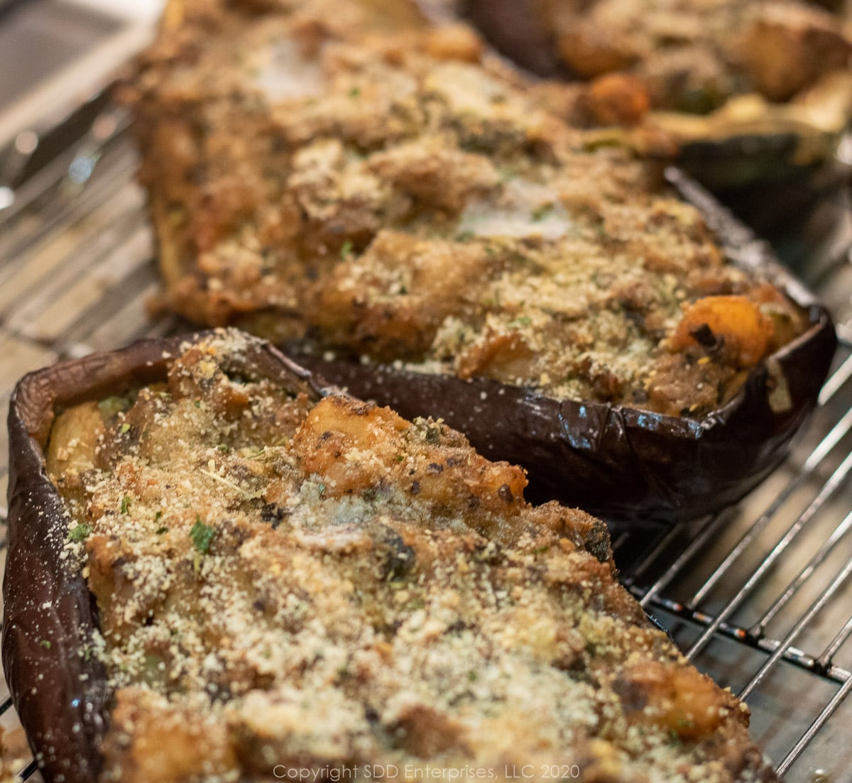 shrimp stuffed eggplant on a cooling rack right out of the oven