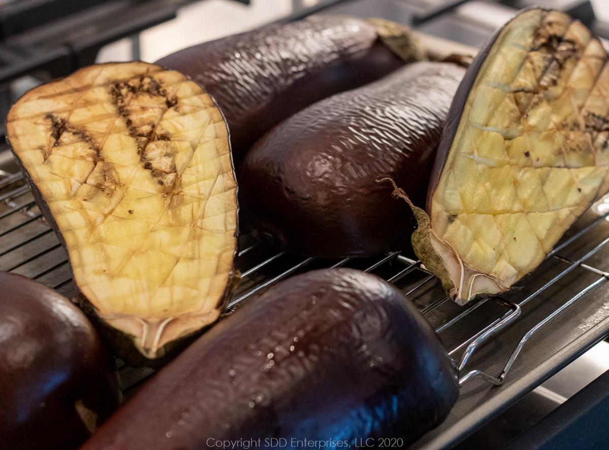 roasted eggplant halves on a cooling rack