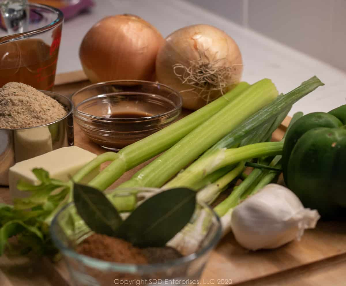 ingredients for stuffed eggplant on a cutting board