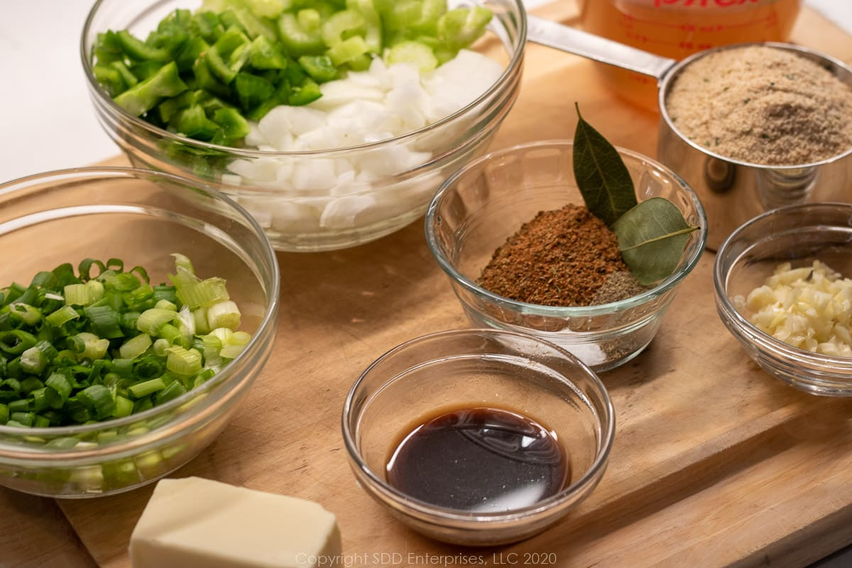 ingredients for stuffed eggplant completely prepped and in individual prep bowls