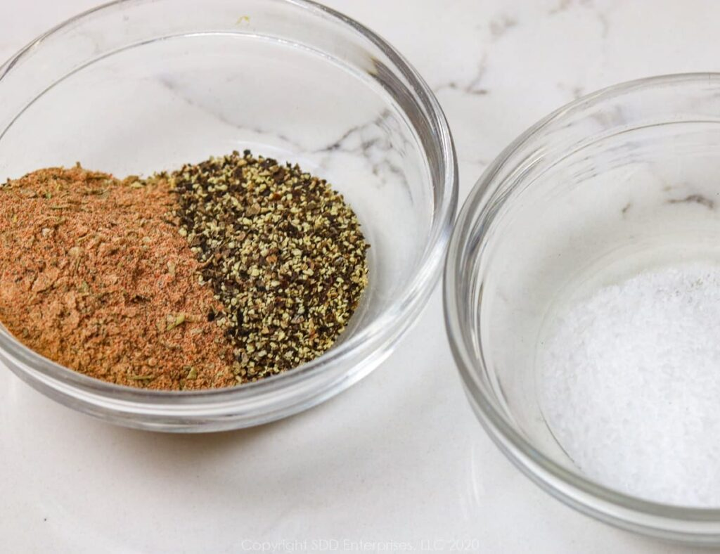 creole seasoning and black pepper in a small bowl and kosher salt in a small bowl