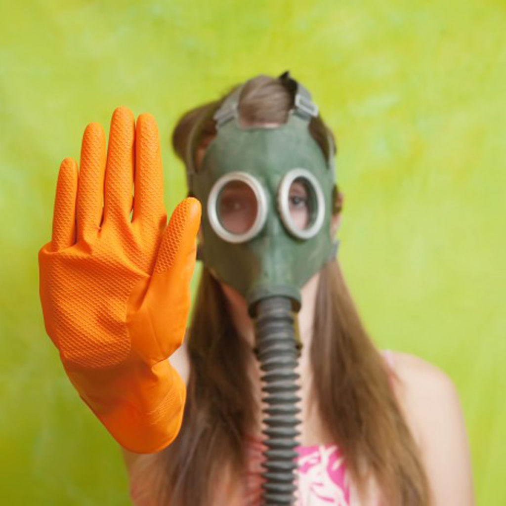 girl with gas mask and orange rubber glove