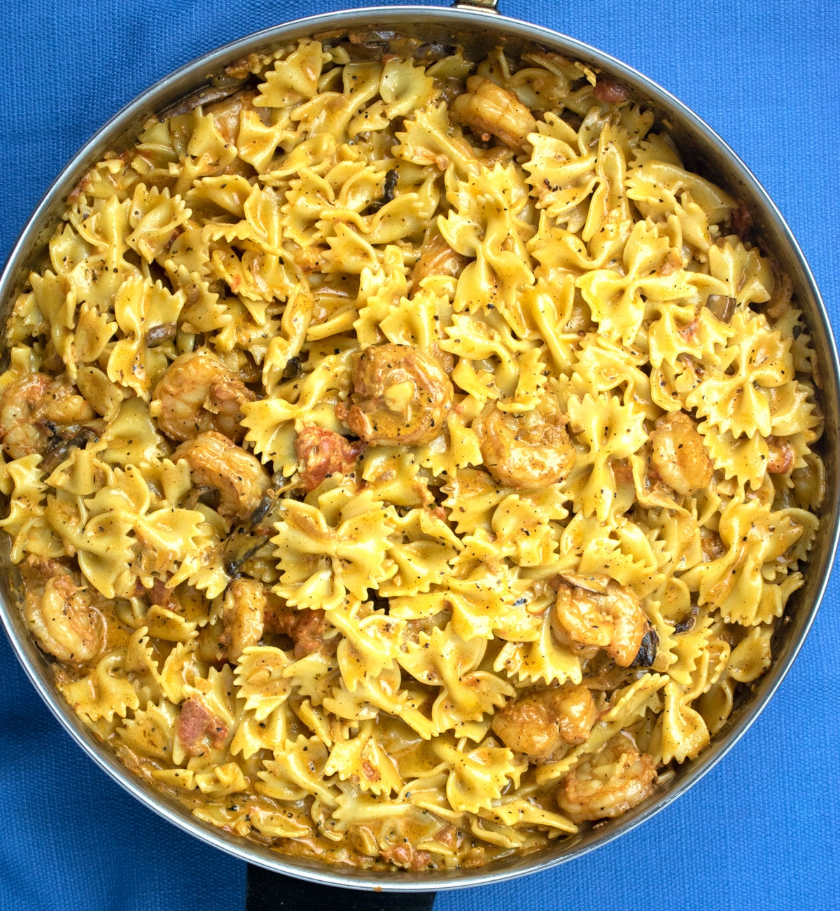 creamy shrimp pasta with mushrooms in a frying pan