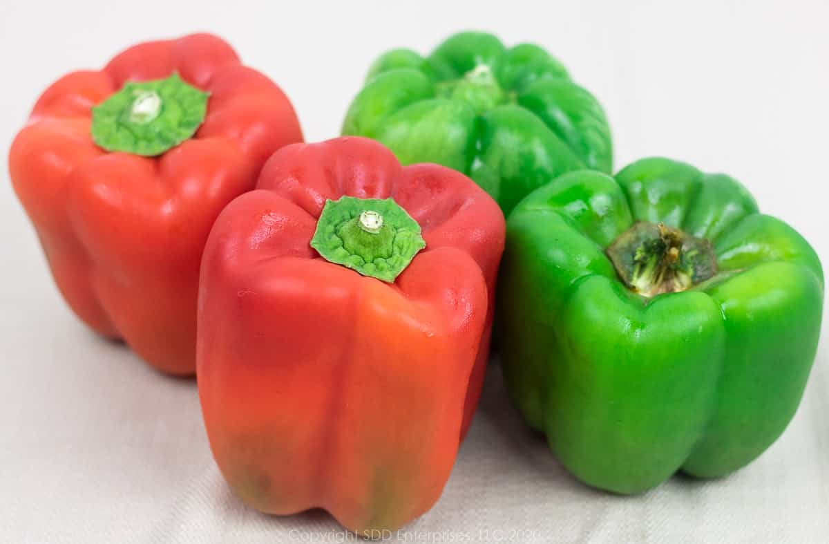 2 red and 2 green whole bell peppers