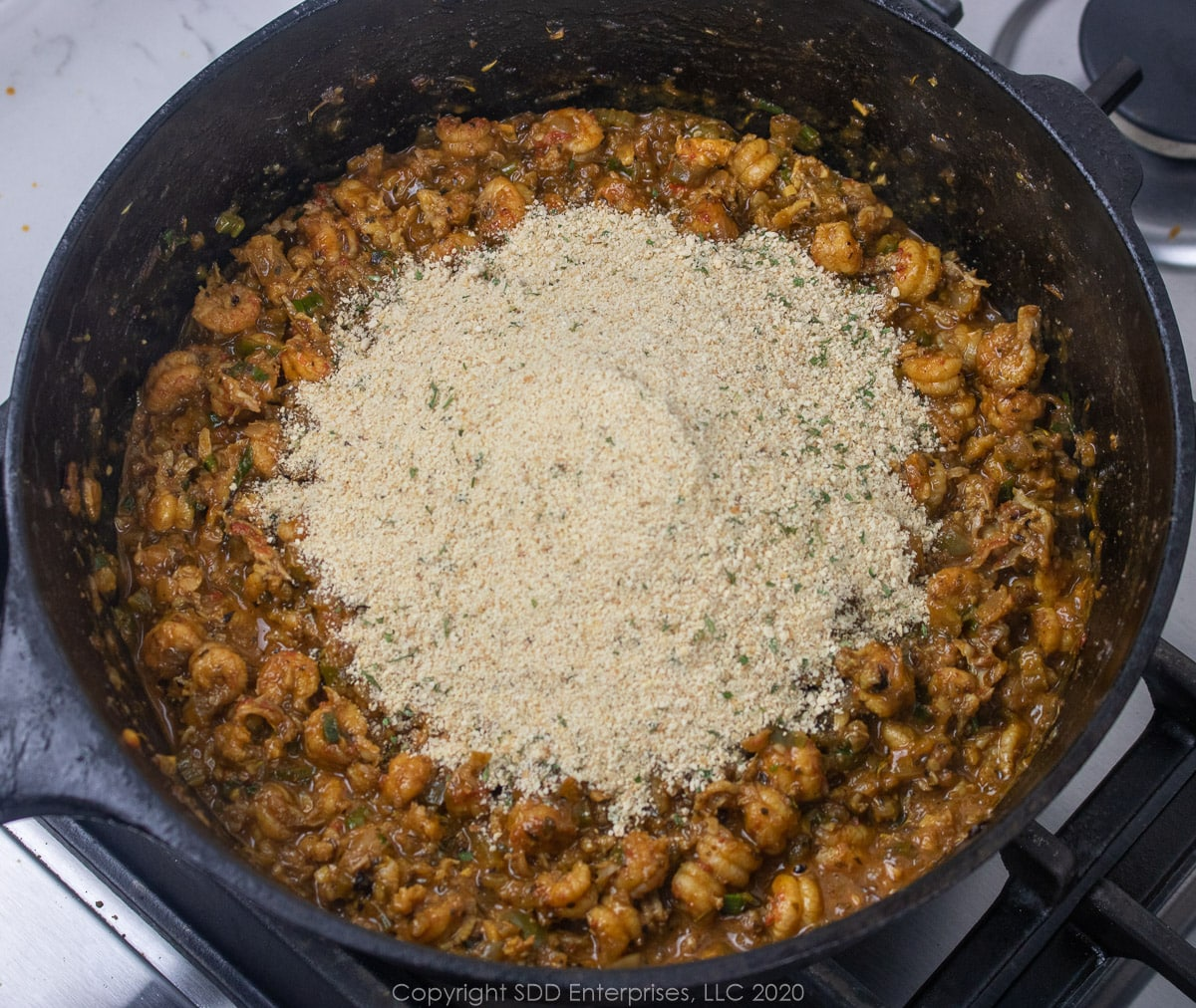 breadcrumbs added to crawfish mixture for cajun stuffed peppers