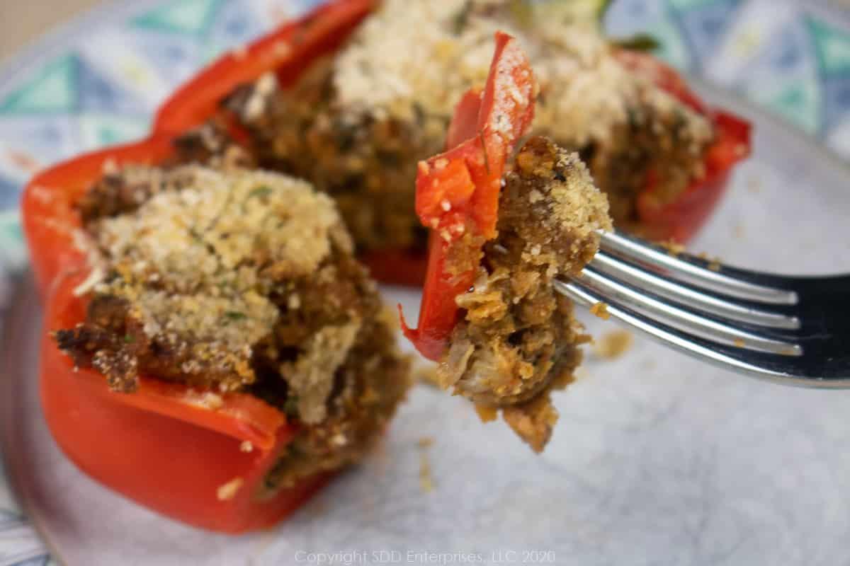 a bite of stuffed pepper on a fork