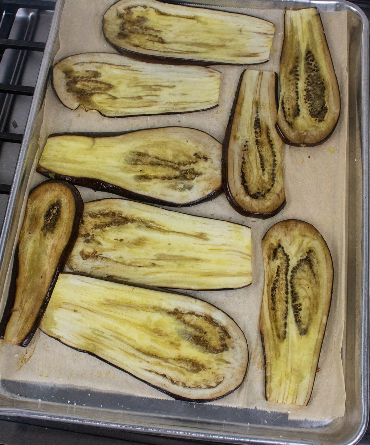 roasted eggplant slices on parchment paper lined baking sheet