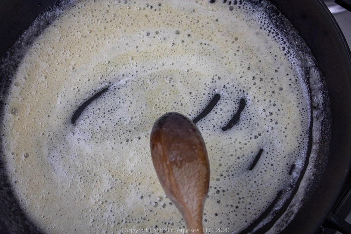 a light roux in a saute pan for creamy crawfish sauce