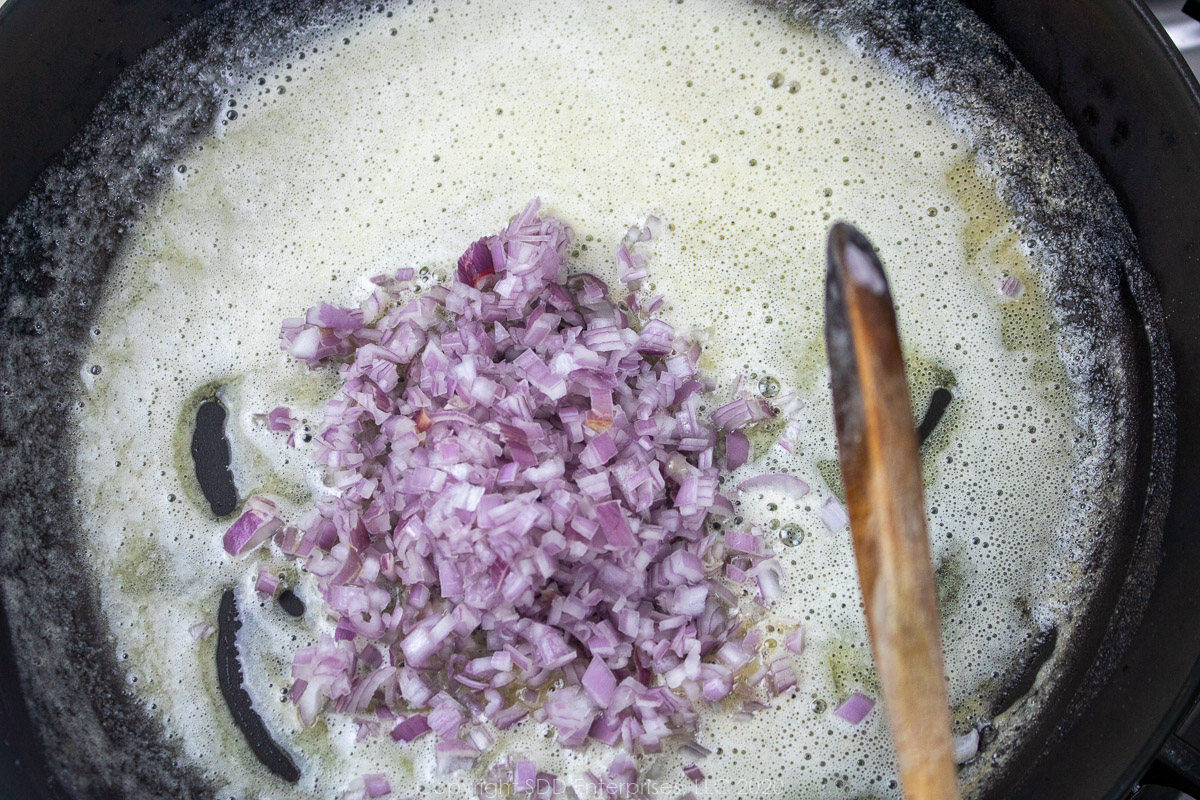 shallots in a light roux in a saute pan