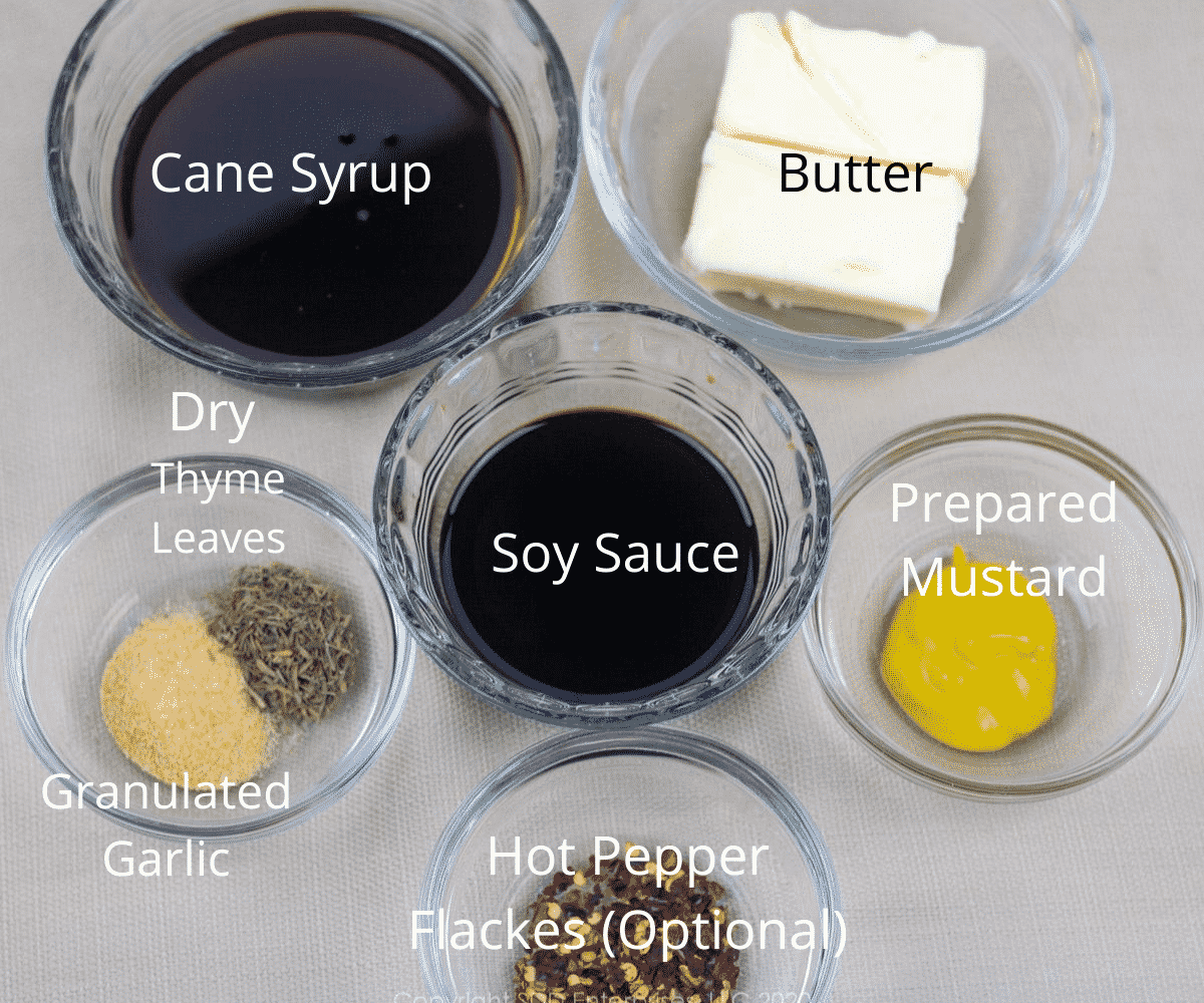 ingredients for cane syrup sauce in small prep bowls with labels
