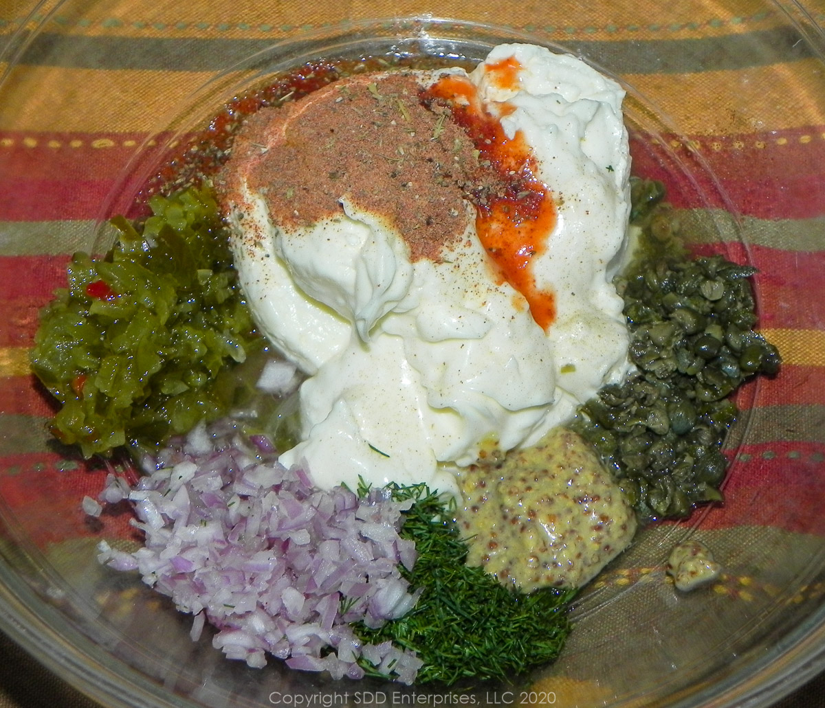 ingredients for creole tartar sauce in a glass bowl