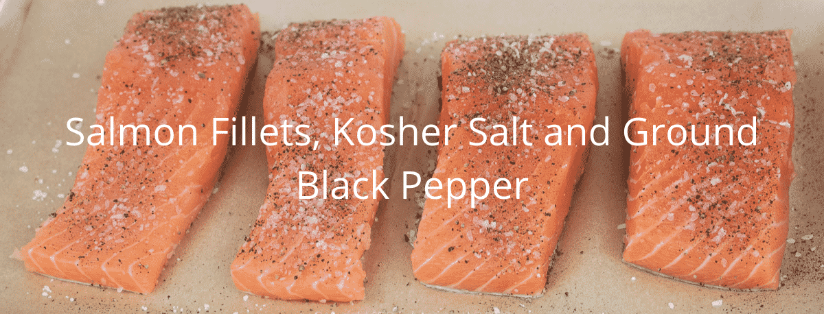 salmon fillets on parchment paper with salt and pepper with graphics