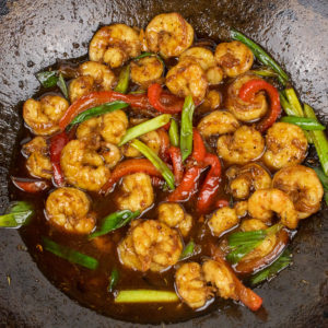 shrimp with cane syrup sauce in a wok