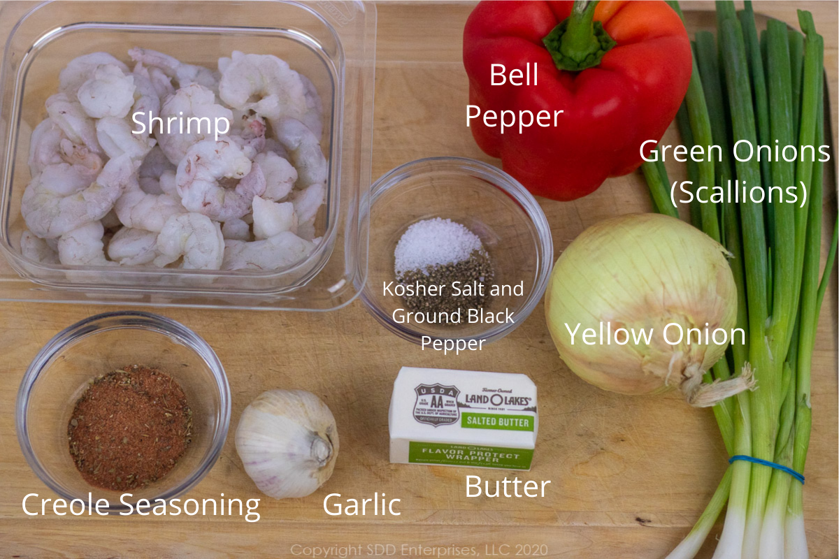 ingredients for shrimp with cane syrup sauce on a cutting board