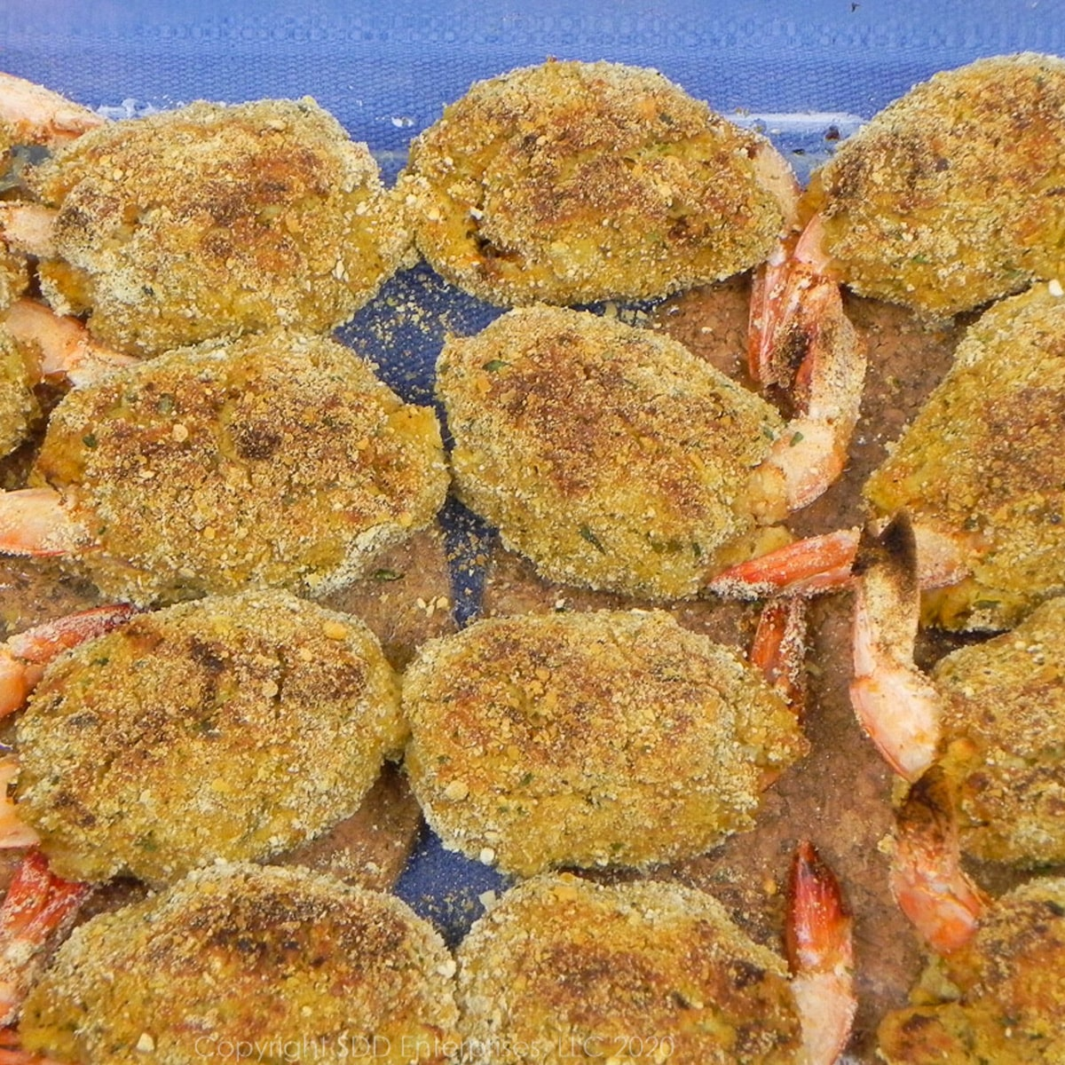 baked crab meat stuffed shrimp in a baking dish