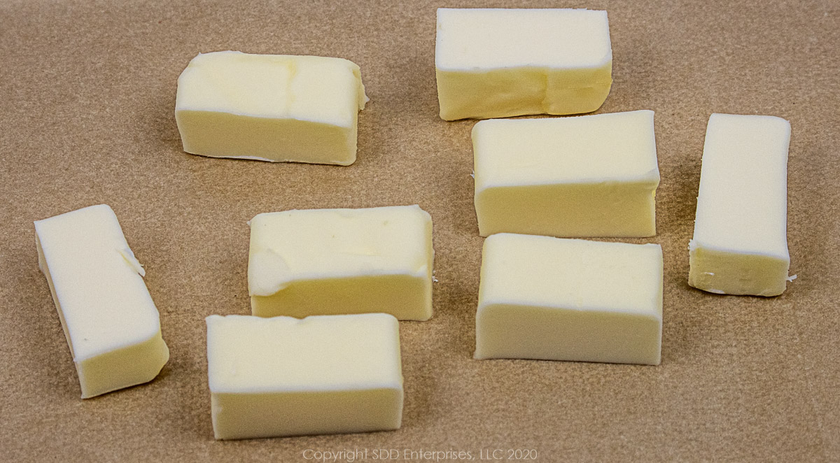 butter cut into ½ tablespoon pieces on parchment paper