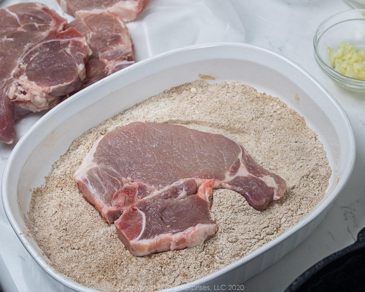 bone-in pork chop in flour dredge