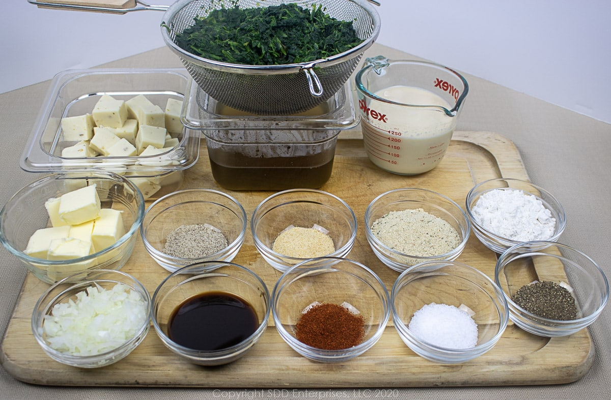 ingredients for spinach Madeleine in separate prep bowls