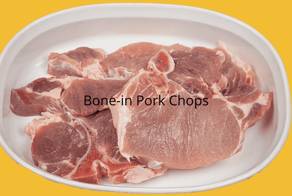 bone-in pork chops on a white platter