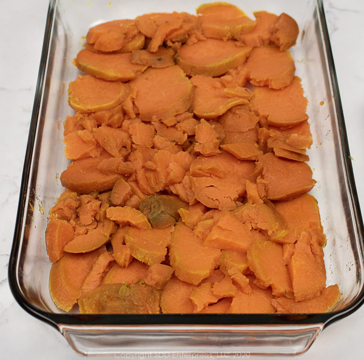 sweet potatoes laid out in a baking dish