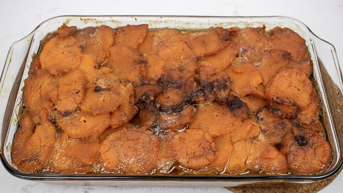 baked candied yams in a baking dish