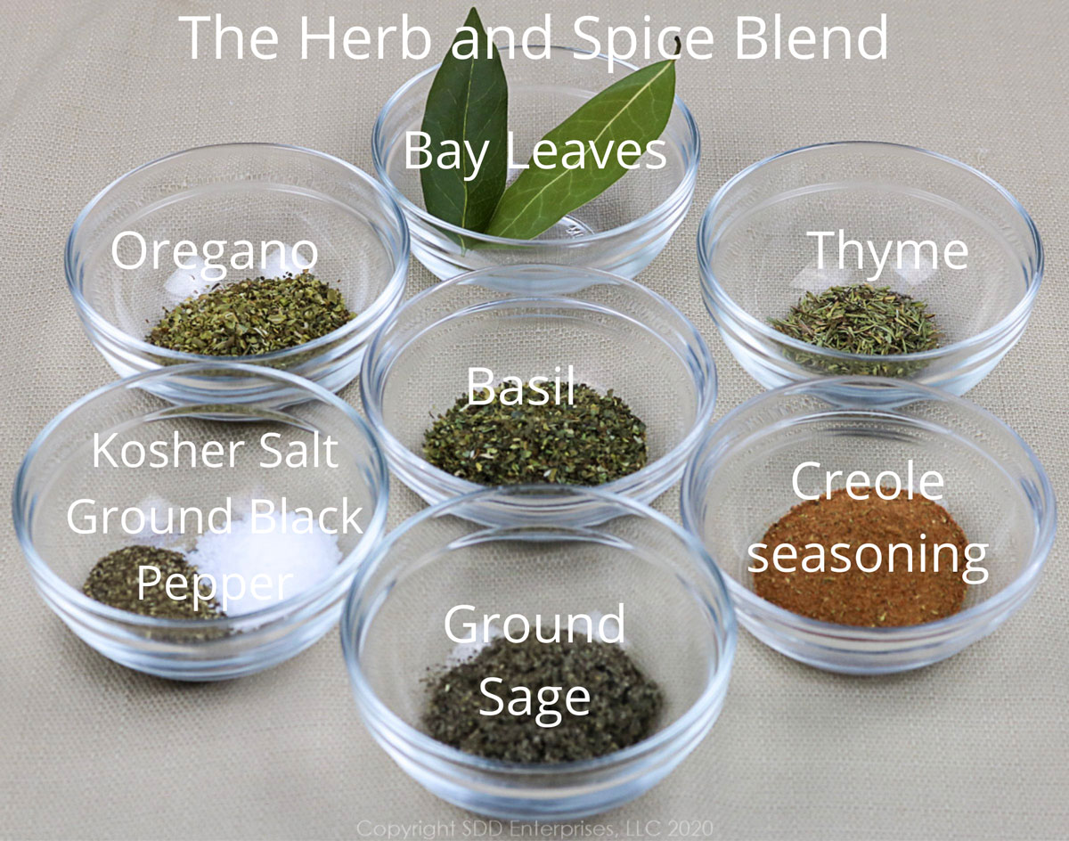 herbs and spices in individual prep bowls for oyster artichoke dressing