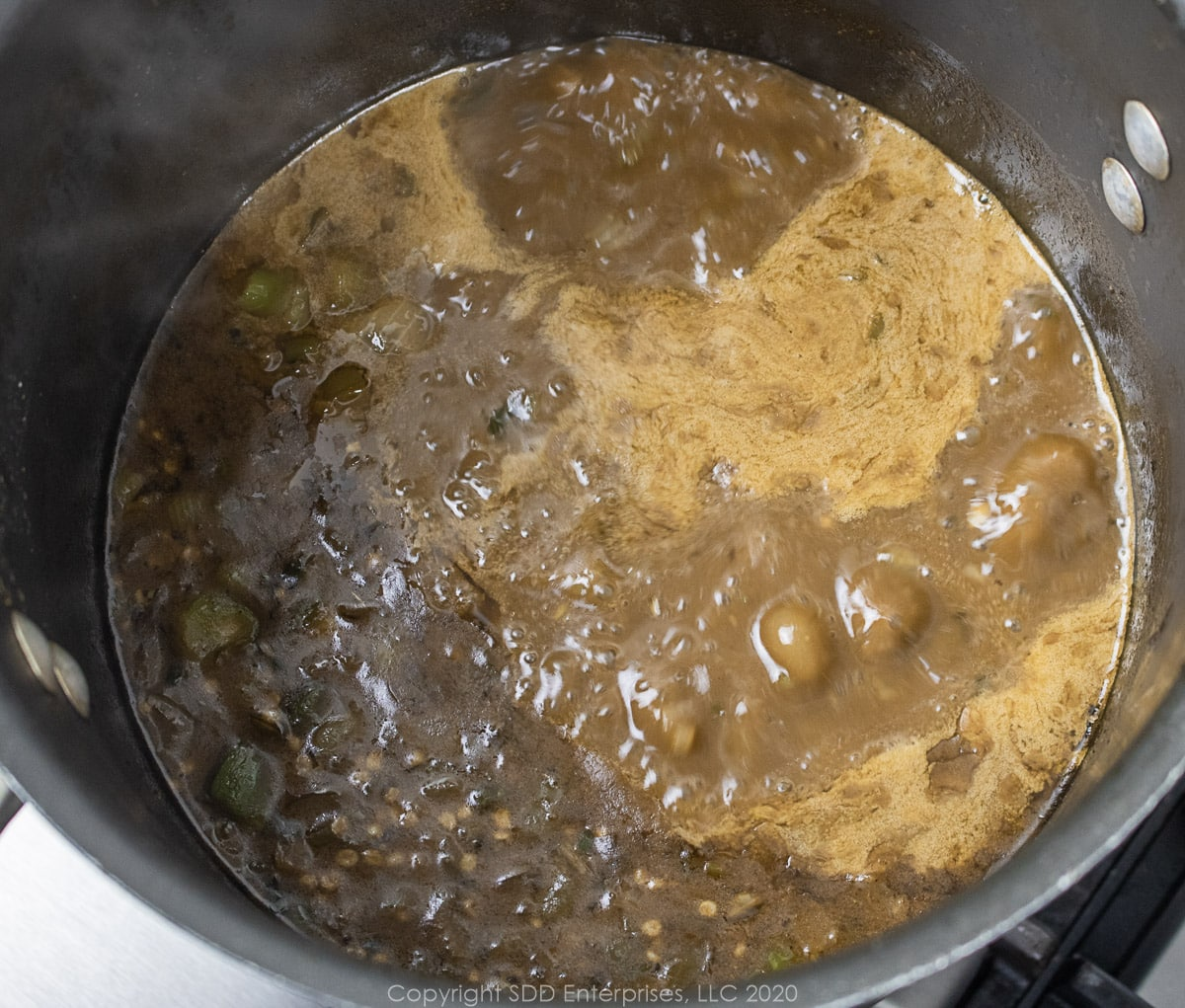 seafood gumbo simmering in a stockpot