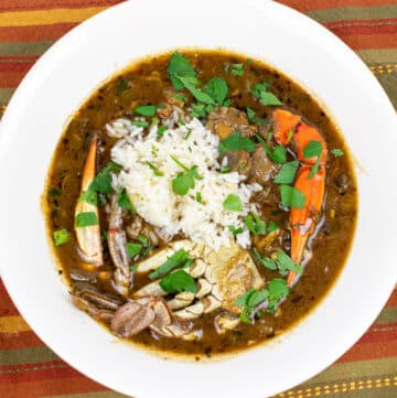 seafood gumbo with rice in a white bowl