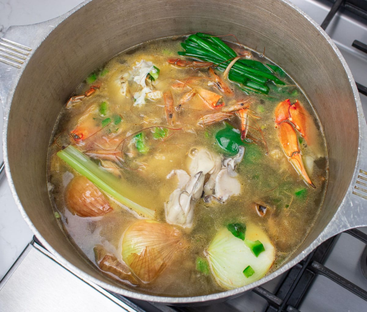 seafood stock simmering in a stockpot