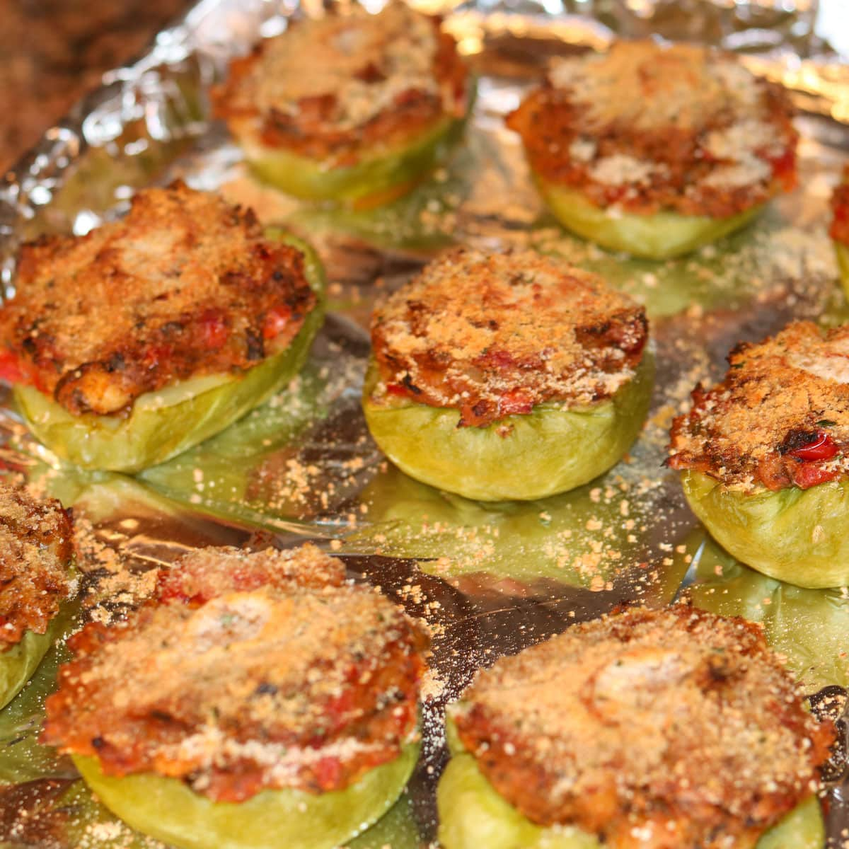 stuffed mirlitons with shrimp on a baking sheet