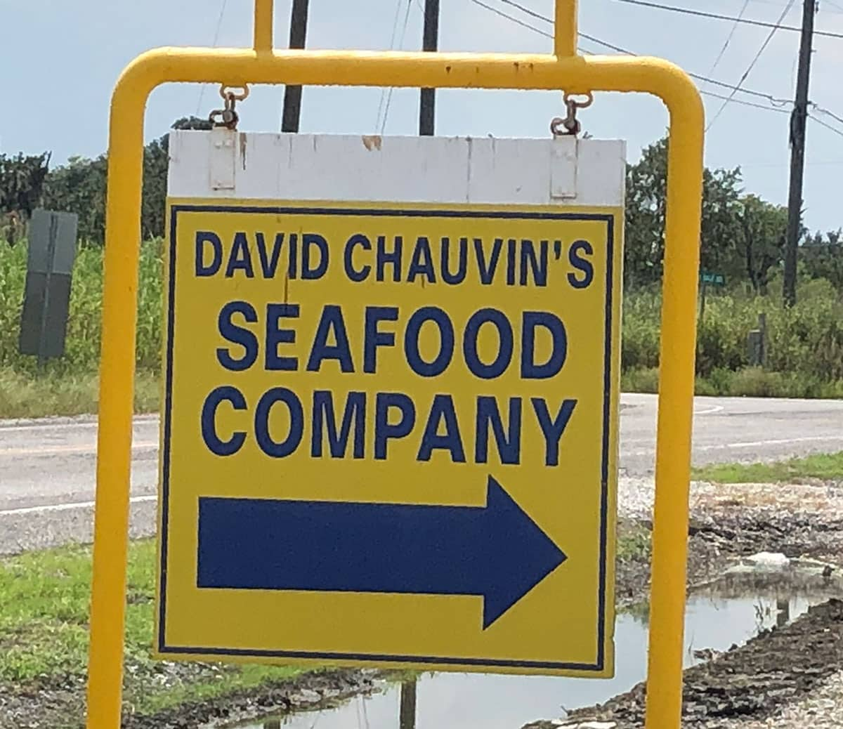 yellow outdoor sign for david chauvin's seafood company