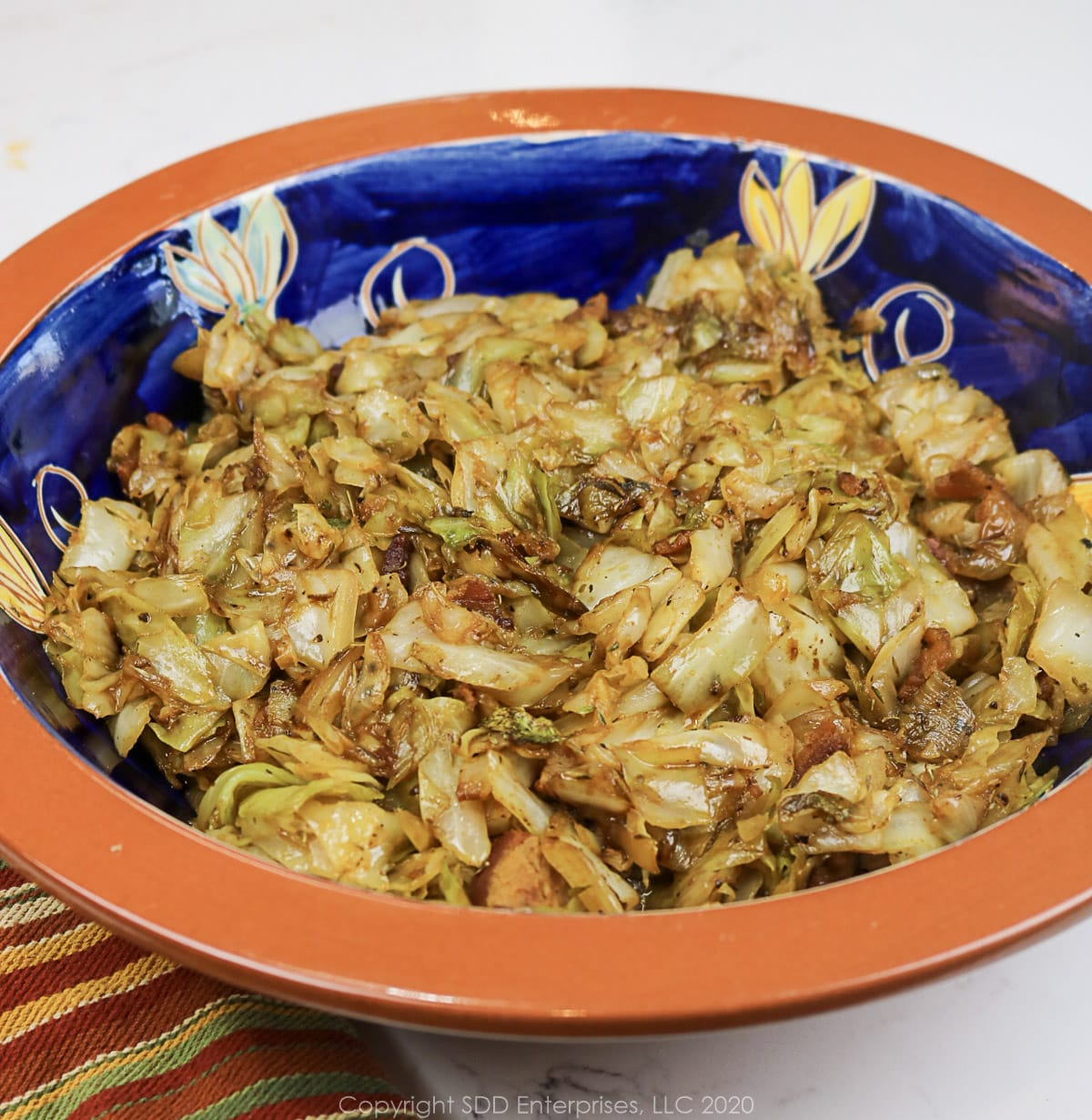 fried cabbage with cane syrup in a decorative bowl