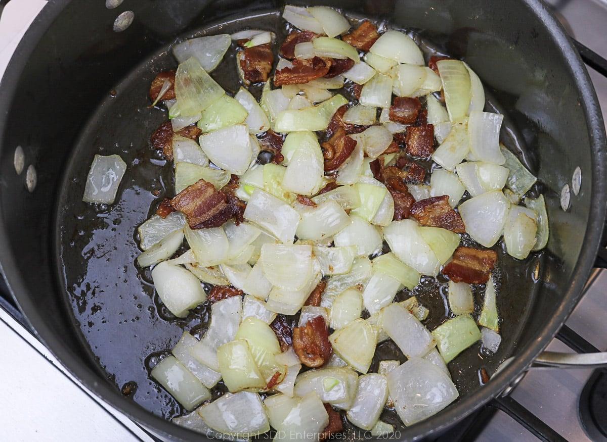 onions aand bacon frying in a dutch oven
