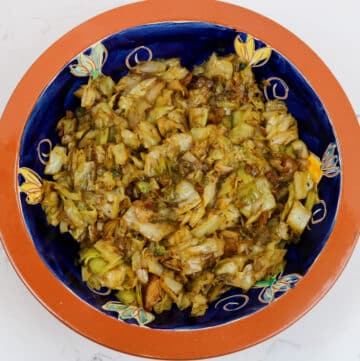 fried cabbage with bacon and cane syrup in a decorative bowl