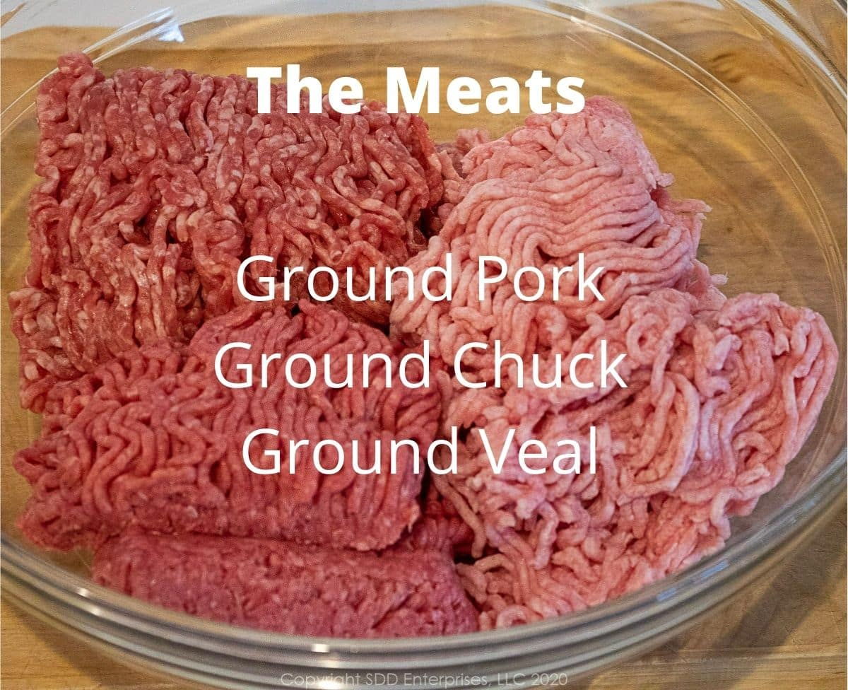 ground beef, pork and veal in a glass bowl