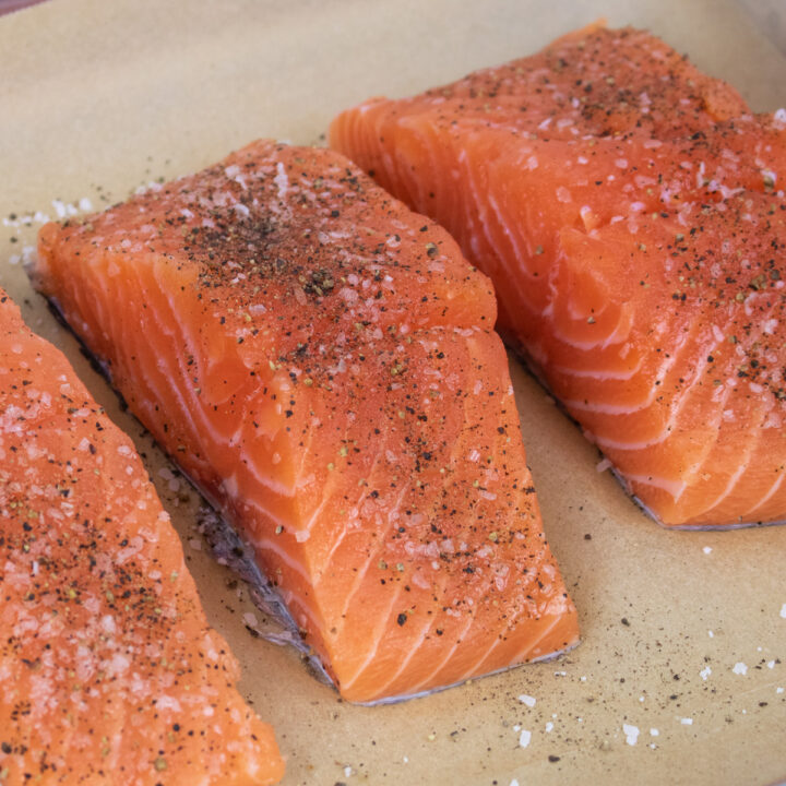 fresh salmon fillets seasoned with salt and pepper