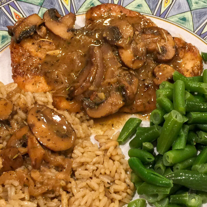 chicken marsala with mushrooms on a plate with rice and green beans
