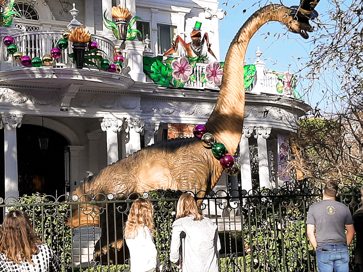 House Float on S Charles Ave with Dinosaur