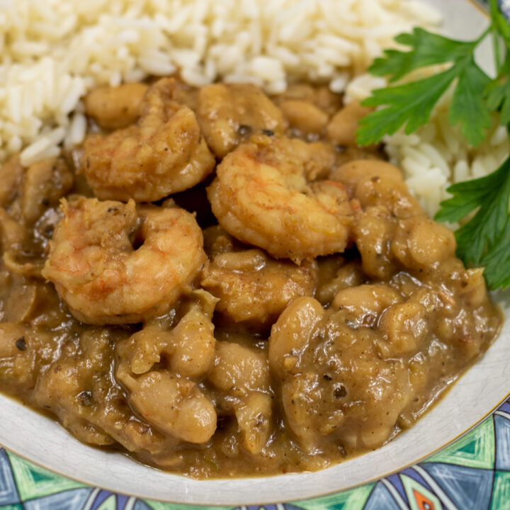 white beans and shrimp with rice and garnish in a bowl
