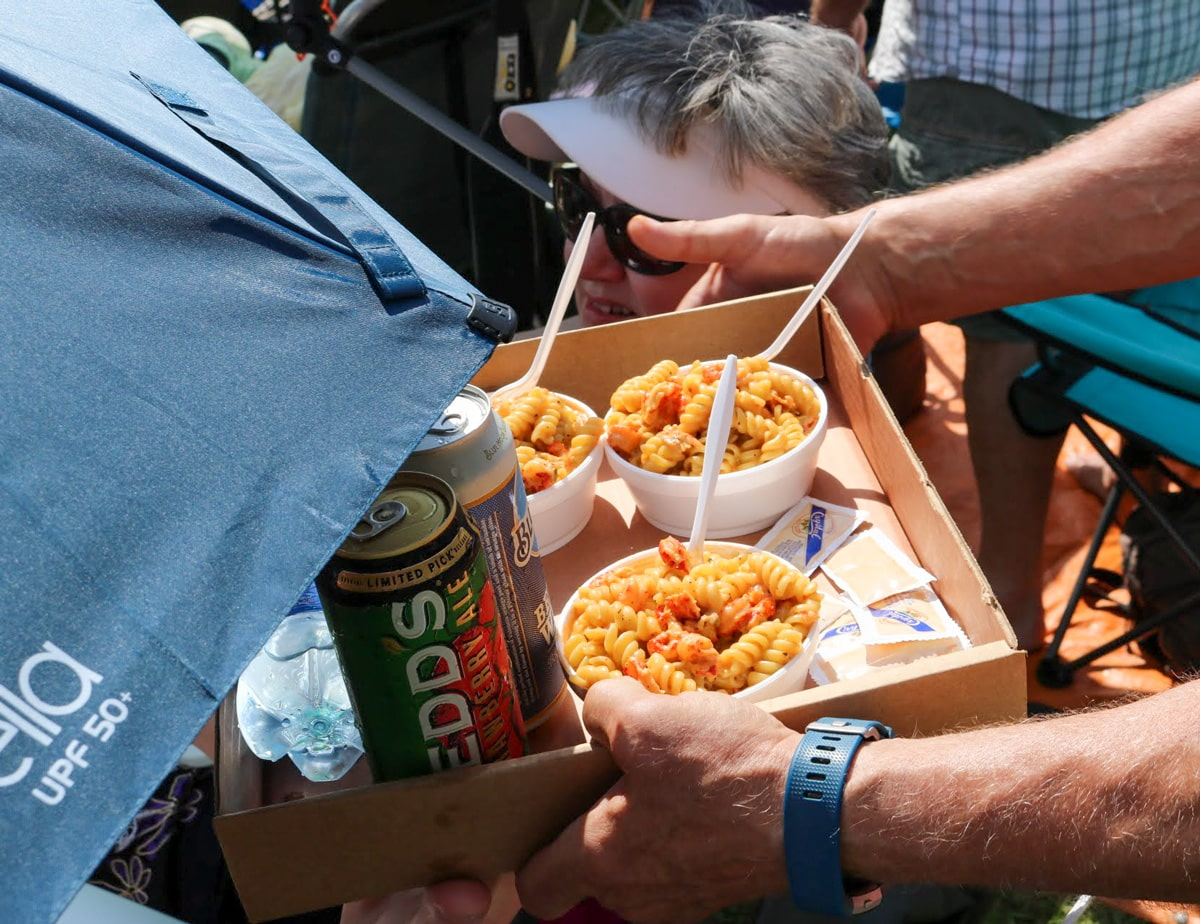 crawfish monica servings in small containers in a box