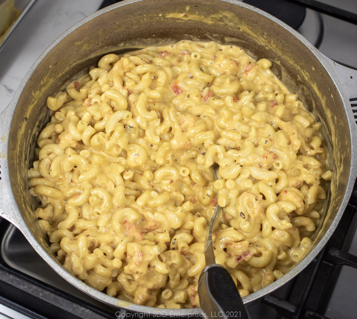 creamy crawfish mac and chhes in a Dutch oven after mixing