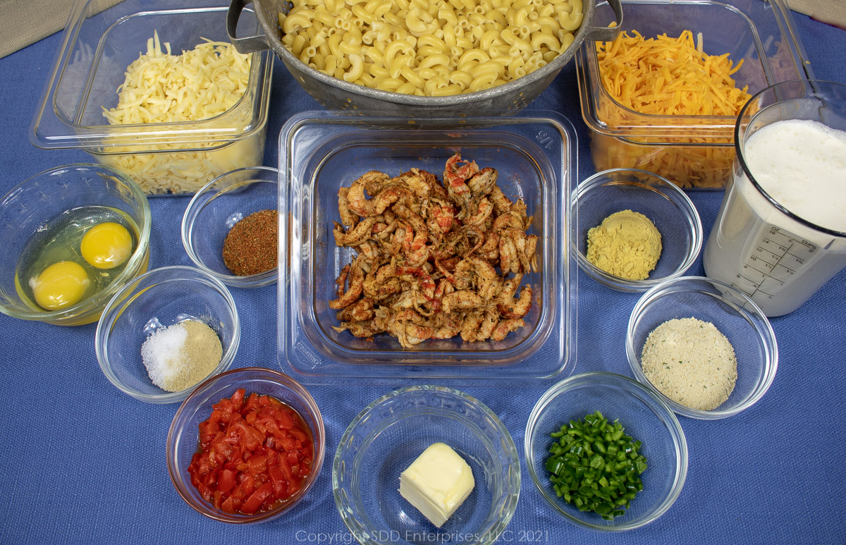 prepared ingredients in prep bowls for crawfish mac and cheese