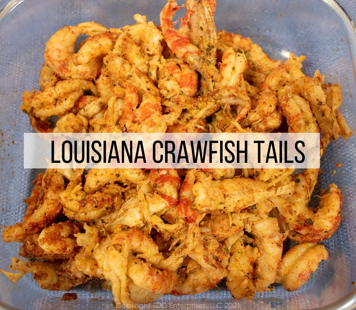 Seasoned Louisiana crawfish tail meat in a prep bowl.