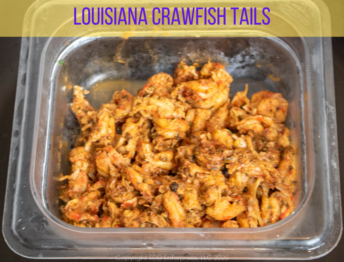 Louisiana Crawfish Tails with seasonings in a prep bowl