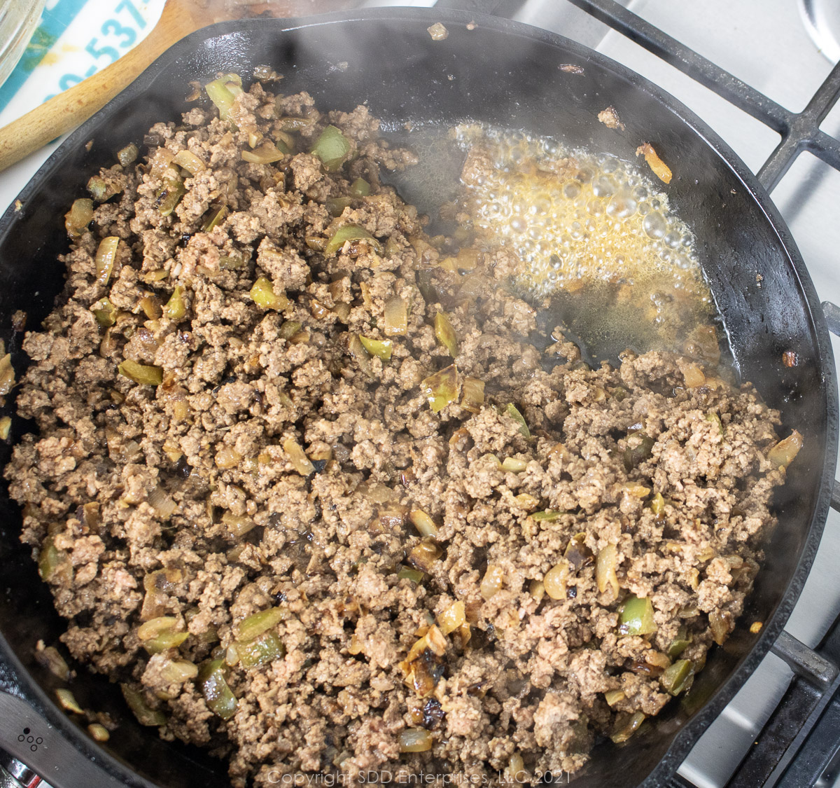 Excess grease from browning ground beef in a cast iron frying pan