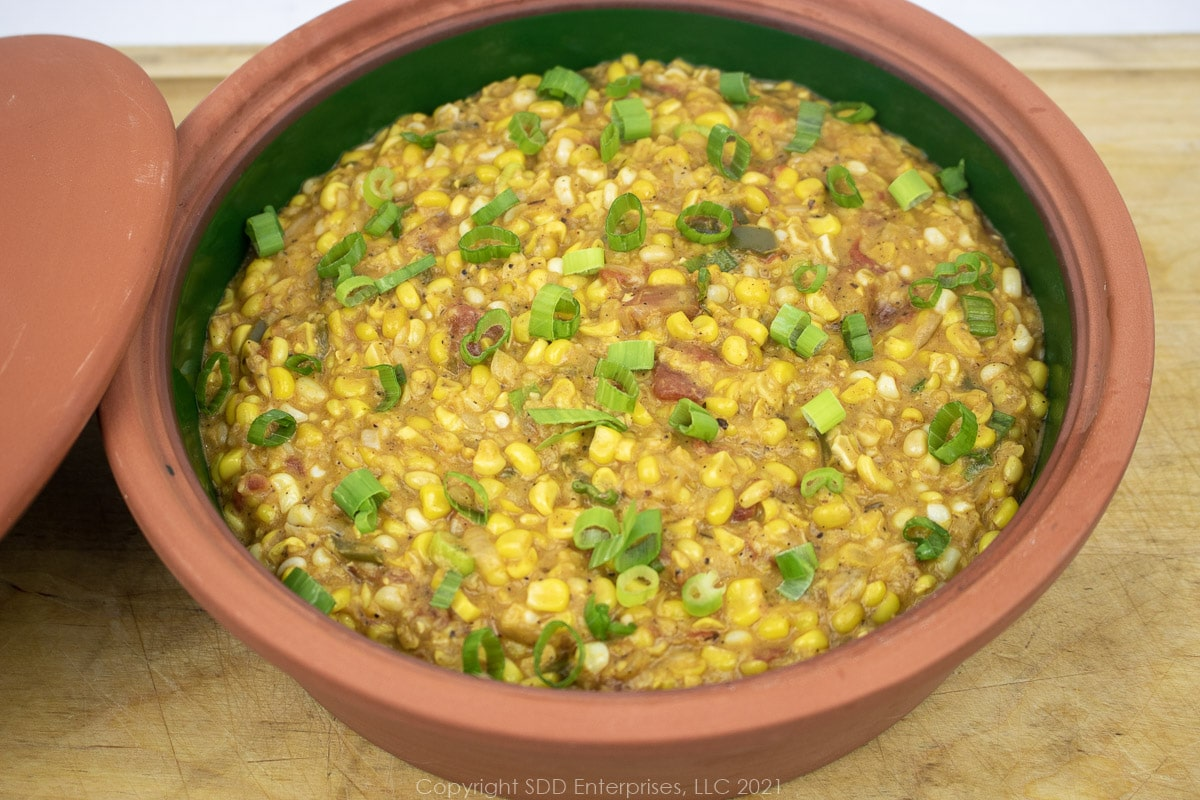 corn maque choux in a brown bowl