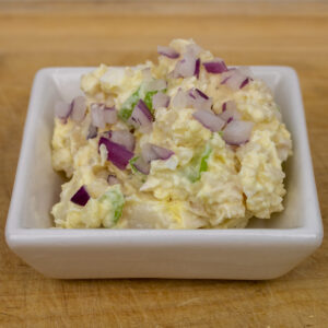 potato salad in a small white bowl
